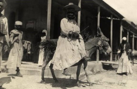 haiti fashion 1916-lady on donkey and street scene